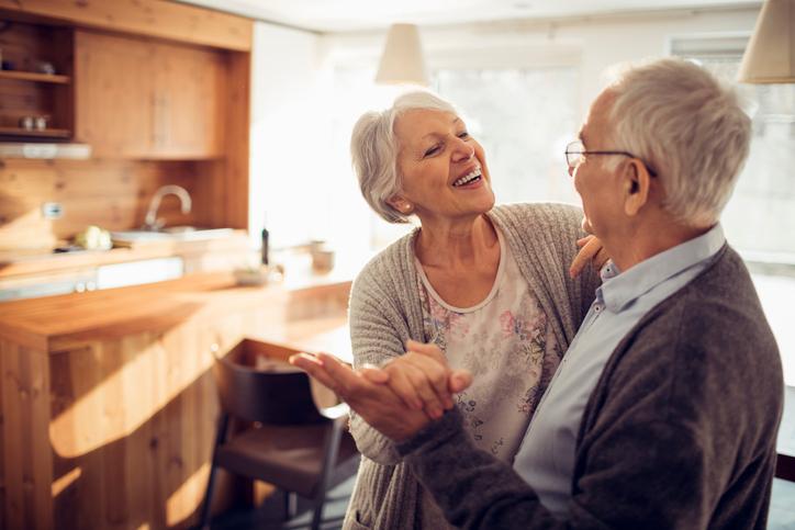 Senior couple dancing in kitchen
